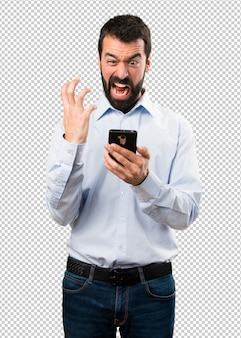 Handsome man with beard talking to mobile