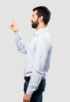 Handsome man with beard touching on transparent screen