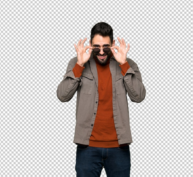Handsome man with beard with glasses and surprised