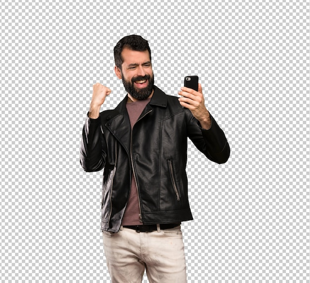 Handsome man with beard with phone in victory position
