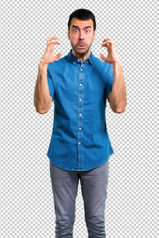 Handsome man with blue shirt  annoyed and angry in furious gesture