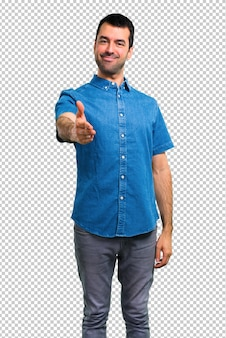 Handsome man with blue shirt handshaking after good deal