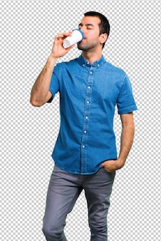 Handsome man with blue shirt holding coffee to take away