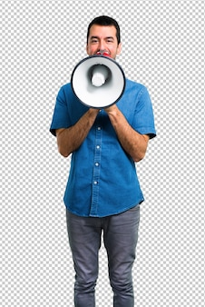 Handsome man with blue shirt holding a megaphone
