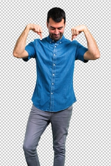 Handsome man with blue shirt pointing down