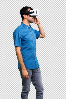 Handsome man with blue shirt using vr glasses