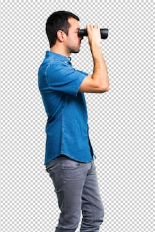 Handsome man with blue shirt with binoculars