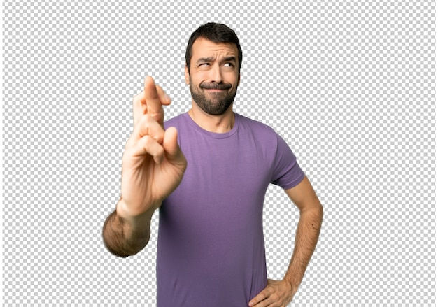 Handsome man with fingers crossing and wishing the best