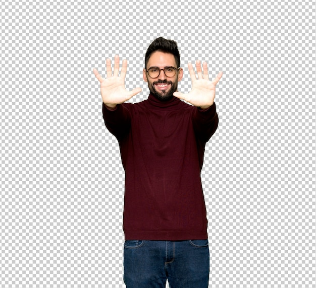 Handsome man with glasses counting ten with fingers