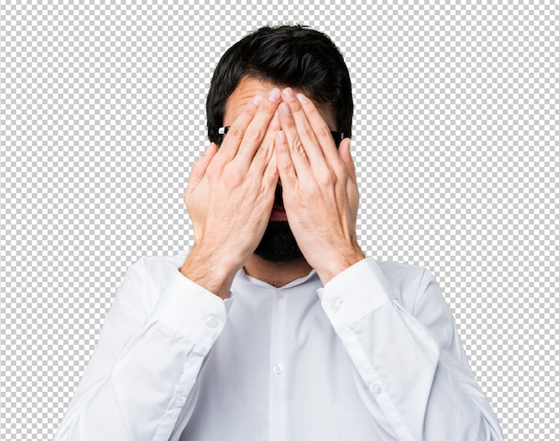 Handsome man with glasses covering his face