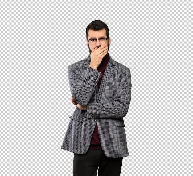 Handsome man with glasses covering mouth with hands