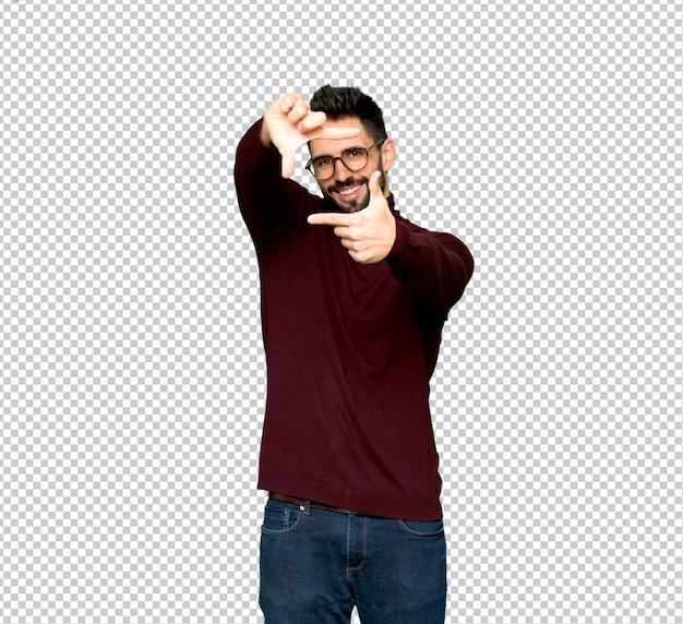 Handsome man with glasses focusing face. framing symbol