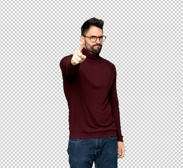 Handsome man with glasses frustrated by a bad situation and pointing to the front