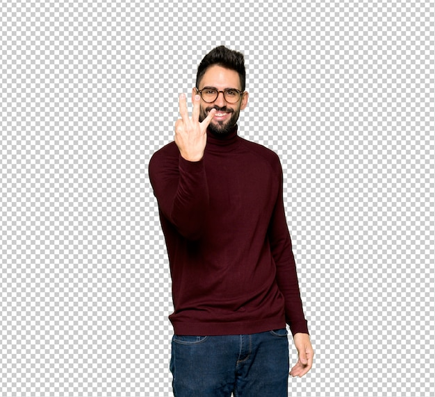 Handsome man with glasses happy and counting three with fingers