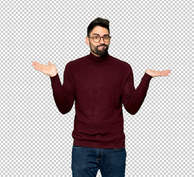 Handsome man with glasses having doubts while raising hands and shoulders