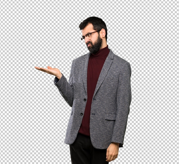 Handsome man with glasses holding copyspace with doubts