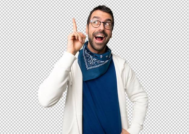 Handsome man with glasses intending to realizes the solution while lifting a finger up