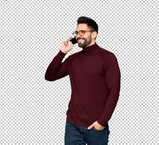 Handsome man with glasses keeping a conversation with the mobile phone