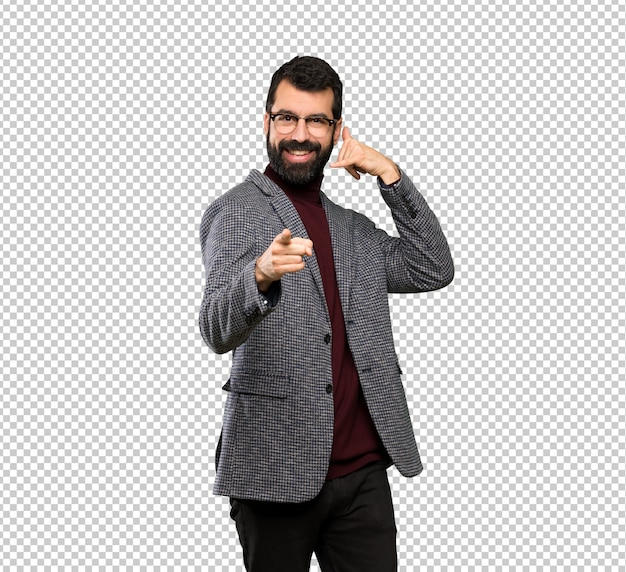 Handsome man with glasses making phone gesture and pointing front