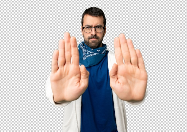 Handsome man with glasses making stop gesture for disappointed with an opinion