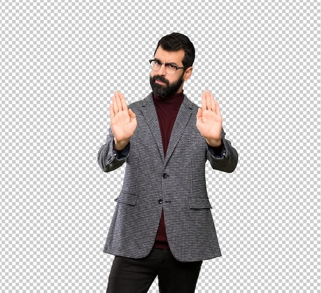 Handsome man with glasses making stop gesture and disappointed