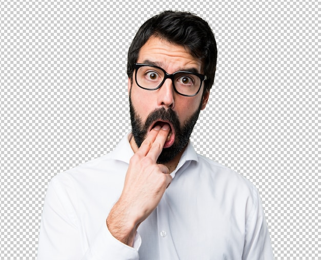 Handsome man with glasses making vomiting gesture