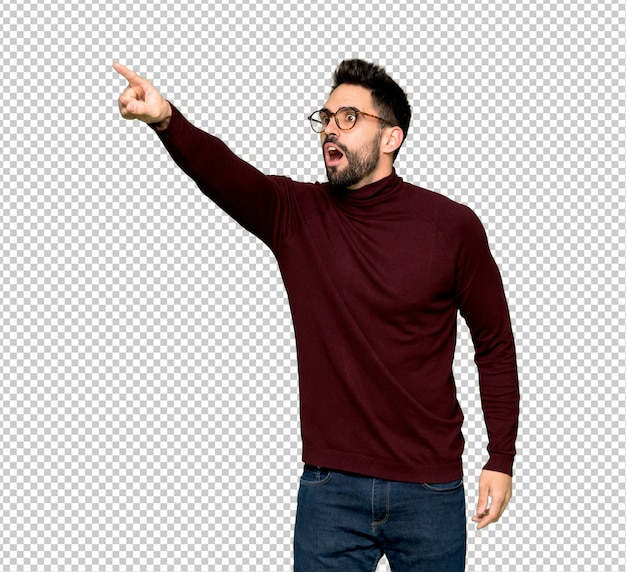Handsome man with glasses pointing away