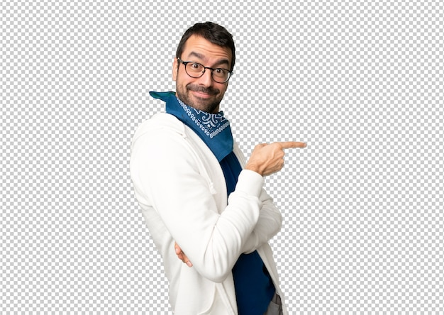 Handsome man with glasses pointing finger to the side in lateral position