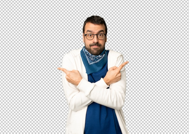 Handsome man with glasses pointing to the laterals having doubts