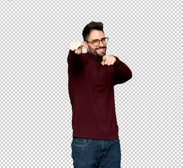 Handsome man with glasses points finger at you while smiling