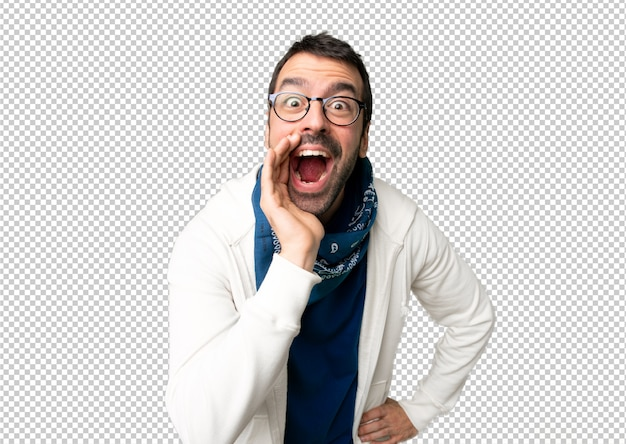 Handsome man with glasses shouting with mouth wide open to the lateral