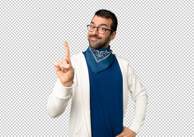 Handsome man with glasses showing and lifting a finger in sign of the best