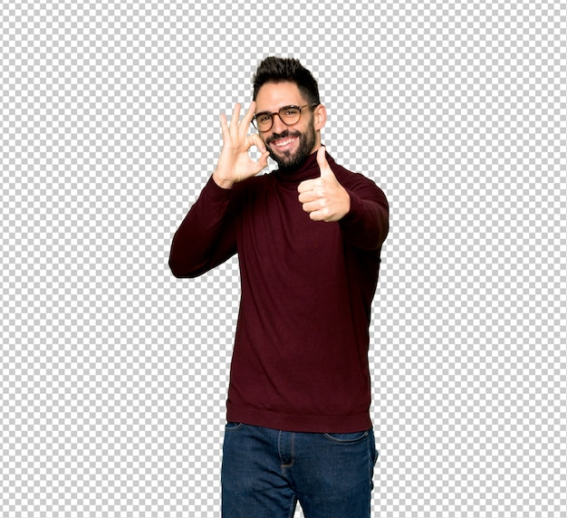 Handsome man with glasses showing ok sign with and giving a thumb up gesture