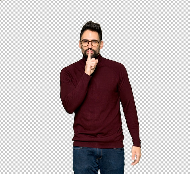 Handsome man with glasses showing a sign of silence gesture putting finger in mouth