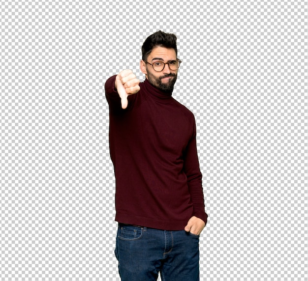 Handsome man with glasses showing thumb down sign with negative expression