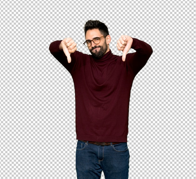 Handsome man with glasses showing thumb down with both hands