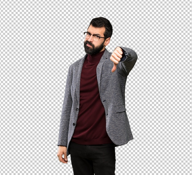 Handsome man with glasses showing thumb down with negative expression