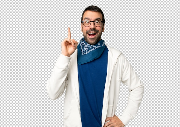 Handsome man with glasses thinking an idea pointing the finger up