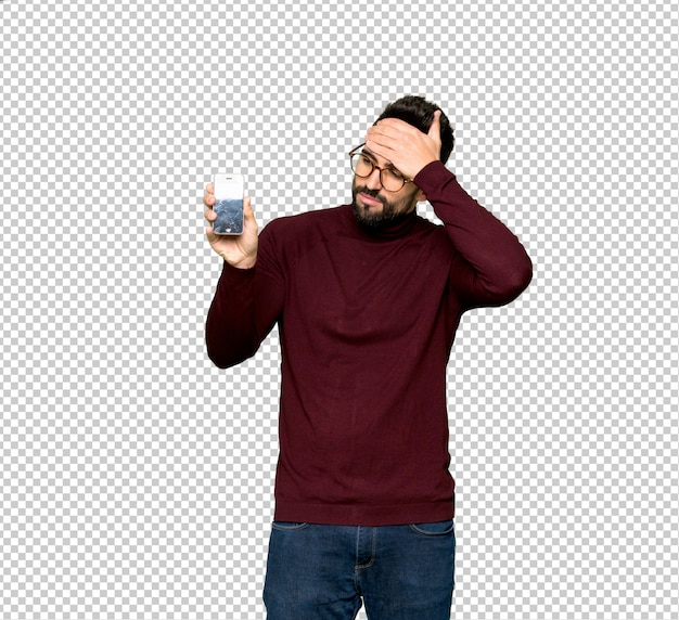 Handsome man with glasses with troubled holding broken smartphone