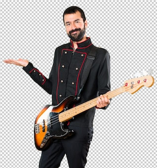 Handsome man with guitar presenting something