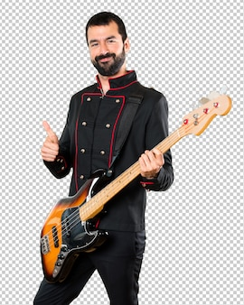 Handsome man with guitar with thumb up