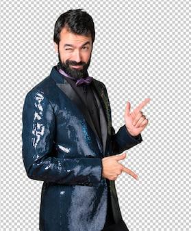 Handsome man with sequin jacket dancing