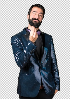 Handsome man with sequin jacket making money gesture