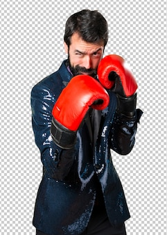 Handsome man with sequin jacket with boxing gloves