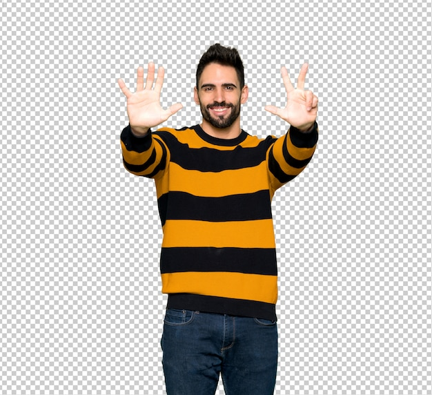 Handsome man with striped sweater counting eight with fingers