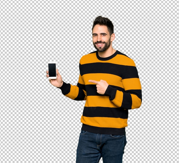 Handsome man with striped sweater happy and pointing the mobile