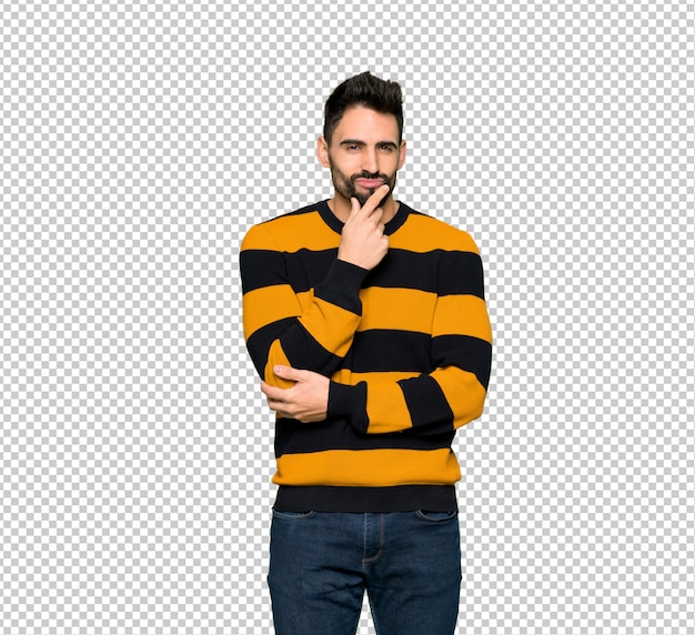 Handsome man with striped sweater smiling and looking to the front with confident face