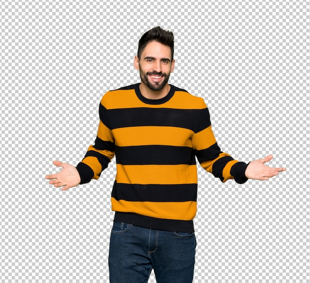 Handsome man with striped sweater smiling