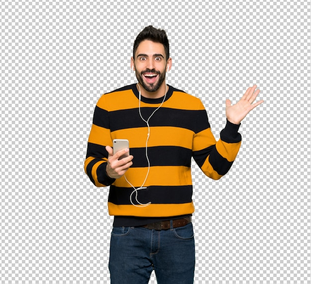 Handsome man with striped sweater surprised and sending a message