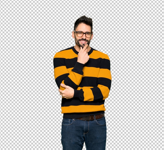 Handsome man with striped sweater with glasses and smiling
